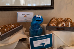 Cookie Monster guarding the cookies table!