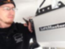 John Huey owner of Johns Garage Door Repair LLC installing LiftMaster garage door opener