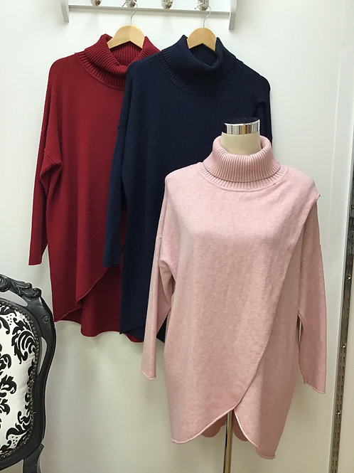 Roll neck jumper with cross over front.