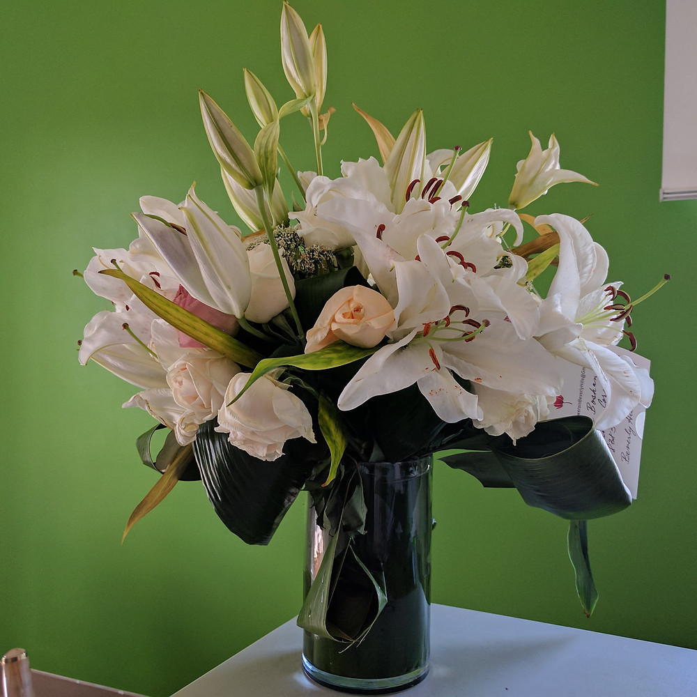 Roses and Lilies from a Boschan Corp. Client