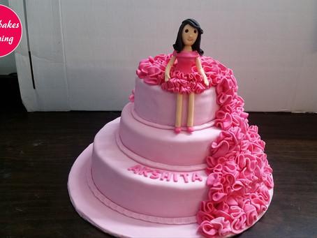 Majestic Pink Ruffle Doll dress cake designing