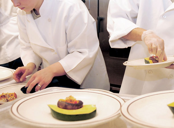 chefs plate a meal All Seasons Insurance