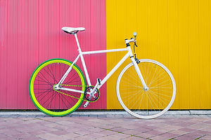 City bicycle fixed gear on yellow and re