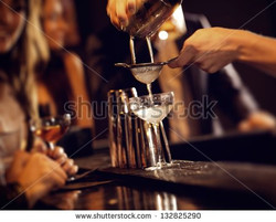 stock-photo-barman-pouring-wine-from-shaker-and-serving-it-132825290