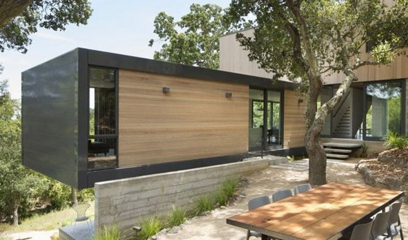 Thermal insulation cladding for shipping container houses