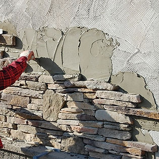 Mortar application of stone wall cladding takes time, and can have its problems