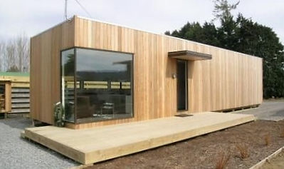 Porcelain insulated cladding for container homes