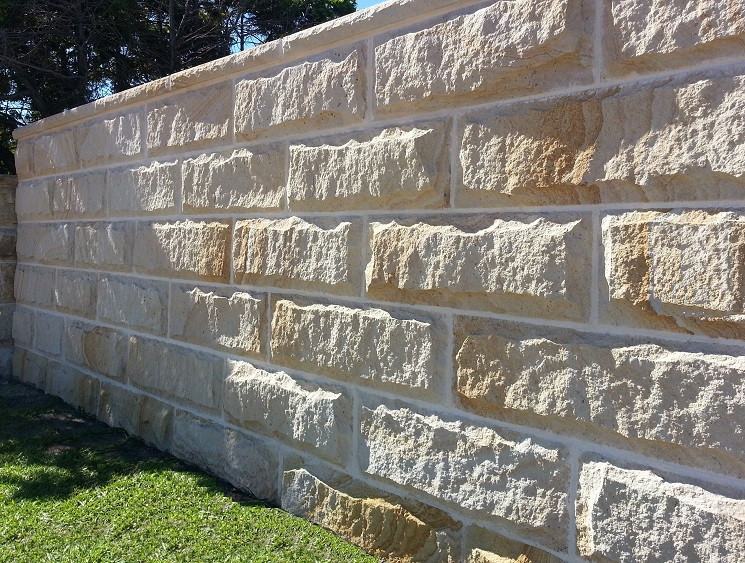 Building a stone wall fence. Fast easy fencing and walling. Wall cladding. Stone veneer siding.
