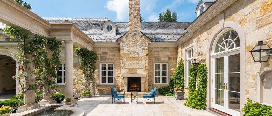 Luxury French Charm stone home. Luxe stone houses. Luxury building