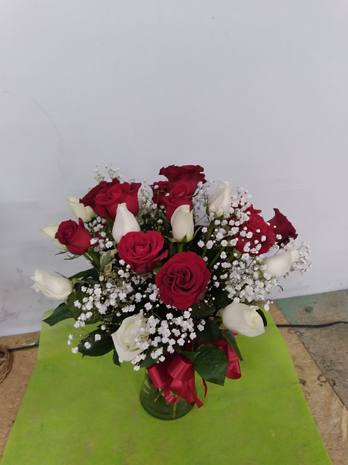 Red and white roses in a clear vase