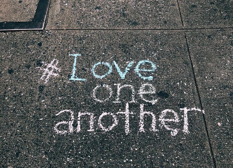 love one another chalk written on concrete floor_edited_edited.jpg
