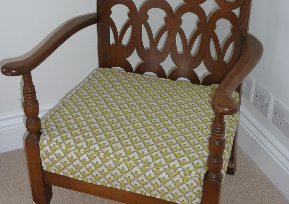 Reupholstered piped seat pad