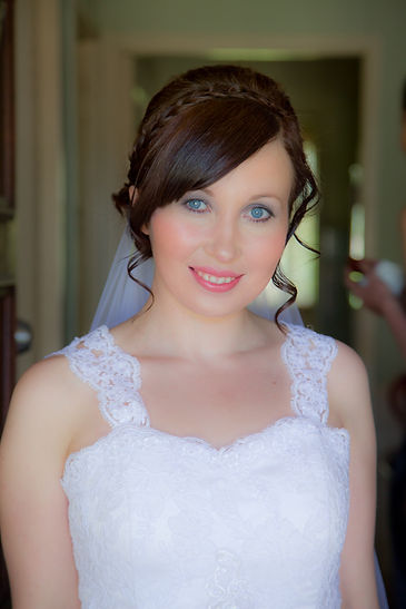 Bride smiling at camera in wedding dress before leaving