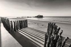 Les ombres s'étirent sur le sable