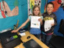school kids showing new printer provide through grant money