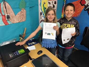 school kids showing new printer provide through grant money
