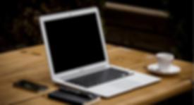 Laptop on desk.png