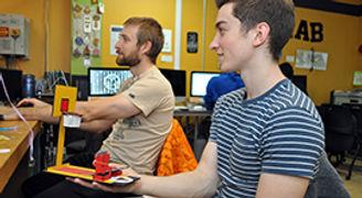 Brad Presler and a Fab Lab Boston intern designing Flick Basketball 2.0 using arduino and infrared sensors