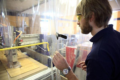 Brad Presler in front of the ShopBot in the Boston Fab Lab