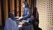 Side profile of MamaSoul at DJ console.