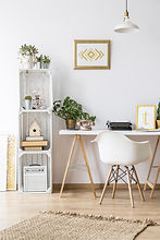 Modern home office area with desk and ar