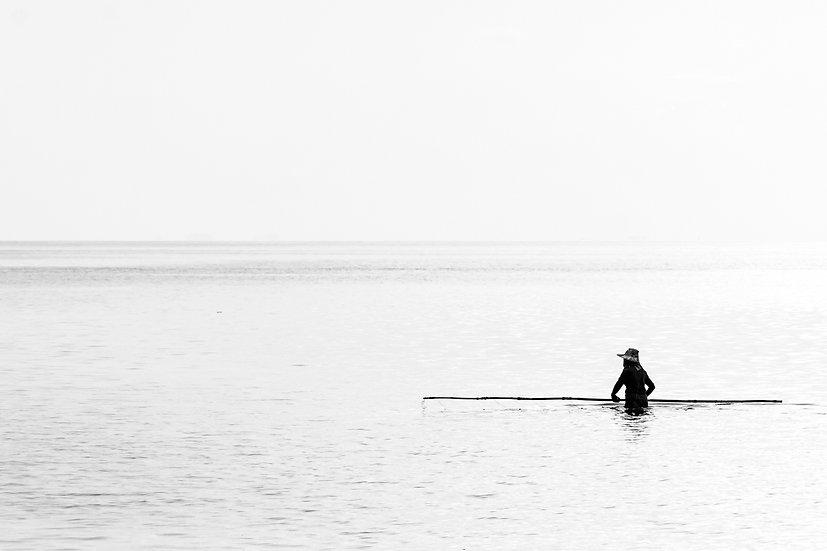 pêcheur avec perche