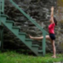 Photo of Cristina Roy doing yoga pose at staircase