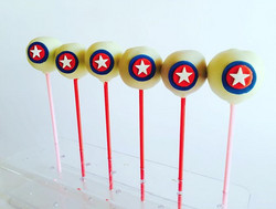 White chocolate mud cake pops colored red for Avengers party_edited