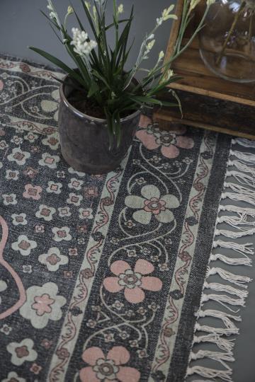 handgewebter Teppich schwarz-rosa mit hellgrünen Blumen