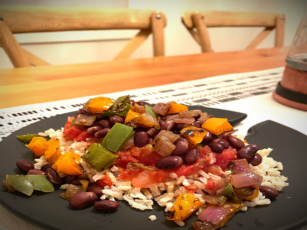 Mexican Rice Bowl with brown rice, sautéed peppers and onions, canned black beans, salsa and cheese.