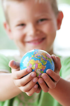 gratitude boy with globe in hands