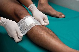person-having-dressing-gauze-bandage-app
