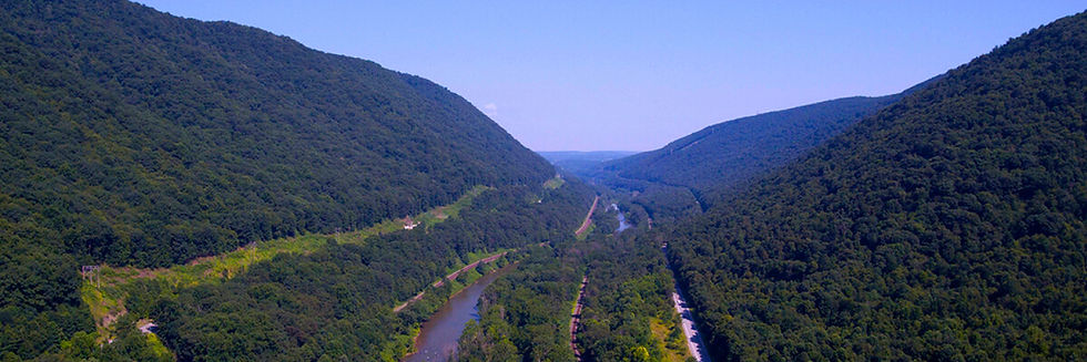 aerial view of wooded valley with river running through in Johnstown, Pennsylvania