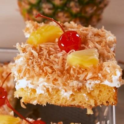Boozy Pina Colada Poke Cake