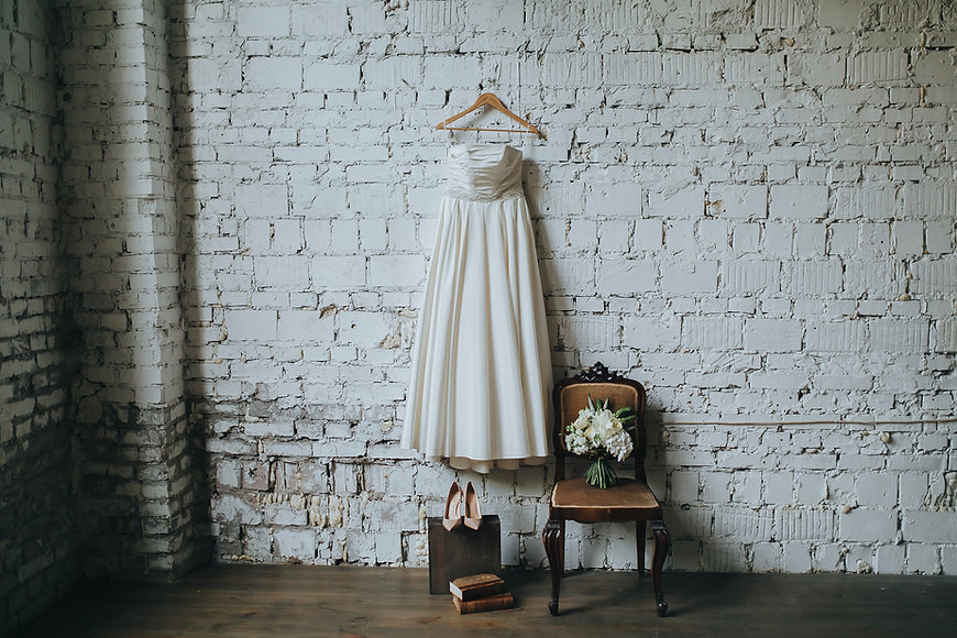 wedding gown, wedding dress, pink shoes, bouquet, white dress, brick wall, exposed brick