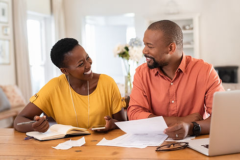 African American adult couple working on finances and tax return