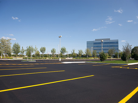 When does my parking lot need cracksealing, sealcoating or restriping?