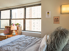 single luxury bedroom with a view of upper east side new york city