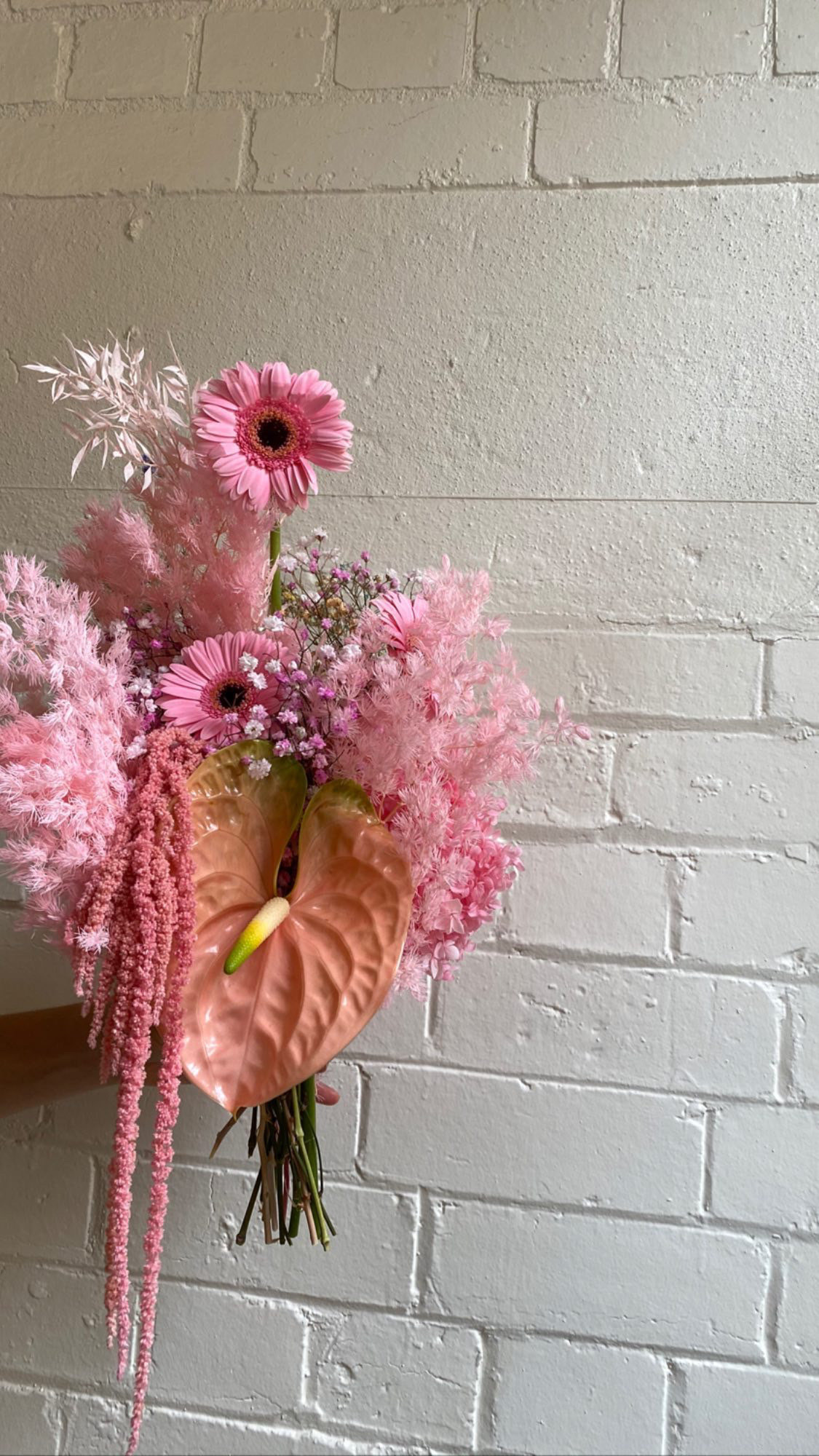 Pink and peach everlasting floral arrangement designed by Melbourne floral artist xxflos
