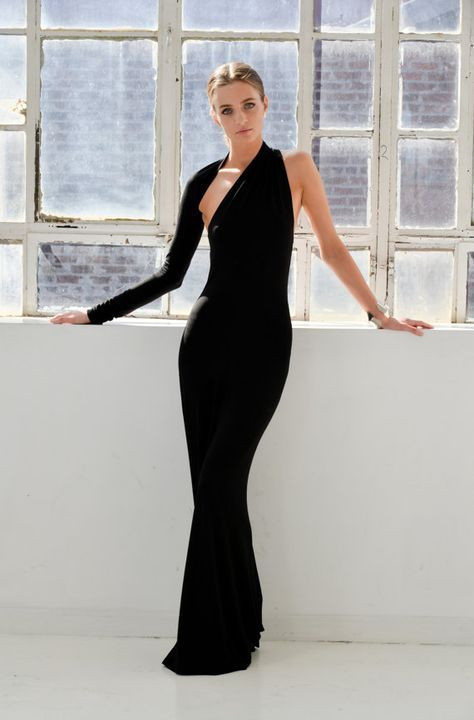 black tie outfit, woman wearing asymmetrical floor length black evening gown