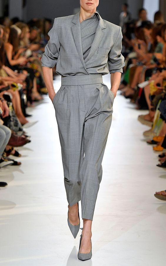 Business Attire dress code, woman on runway wearing grey pantsuit