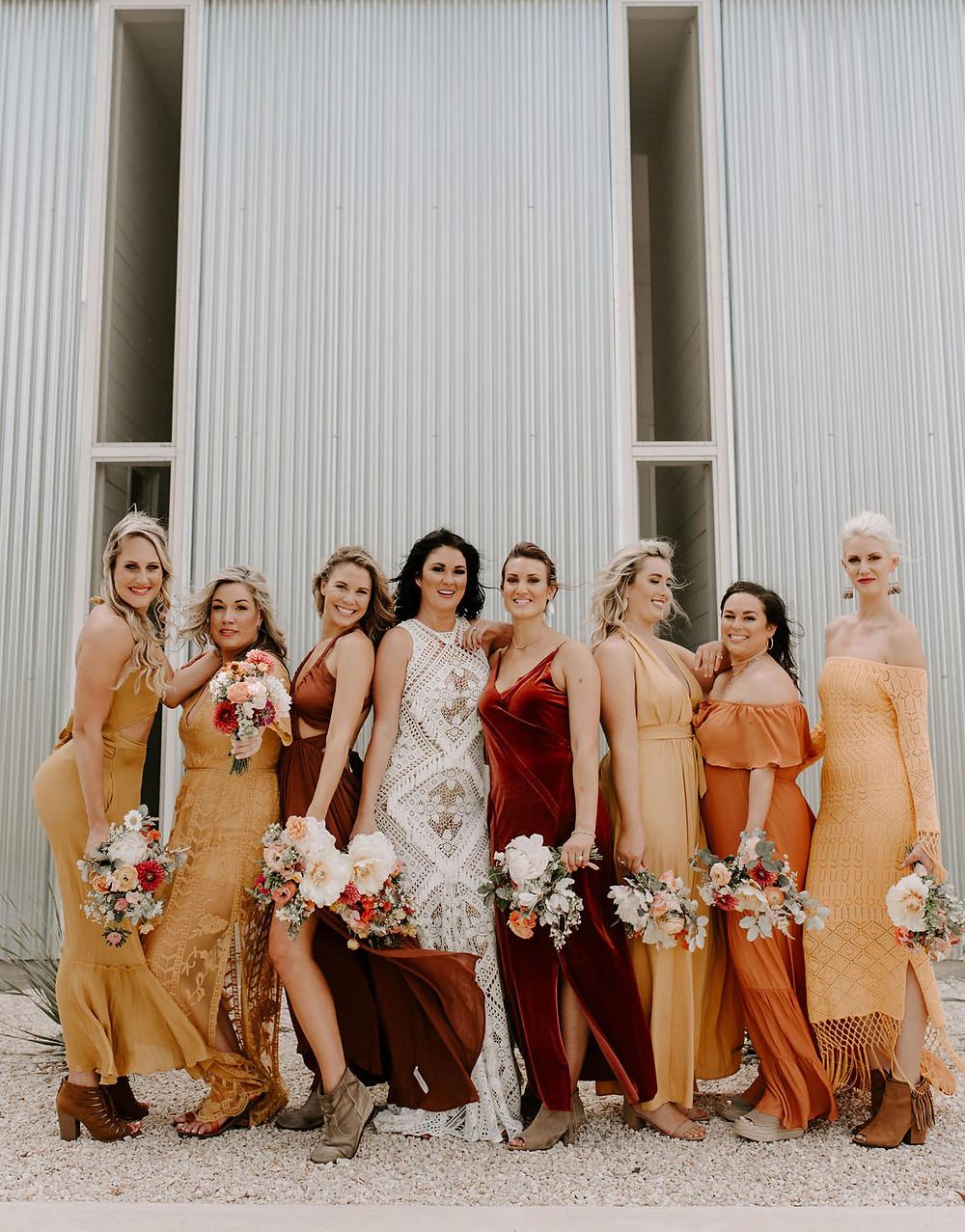 Rust coloured bridesmaids dresses, bridal party group photo
