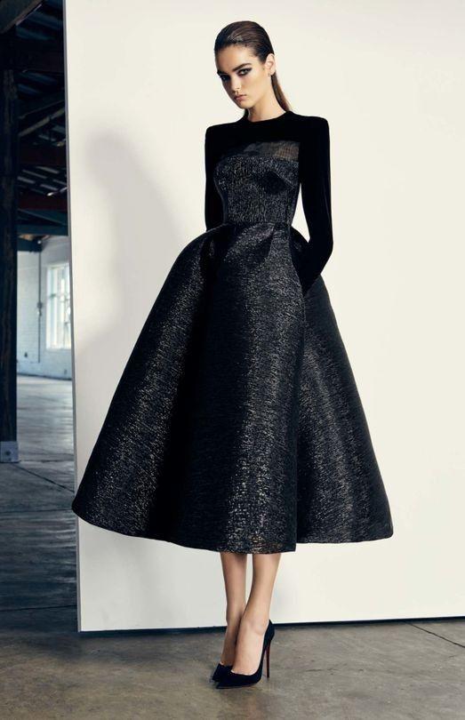 black tie optional attire, woman wearing mid length ballroom black dress