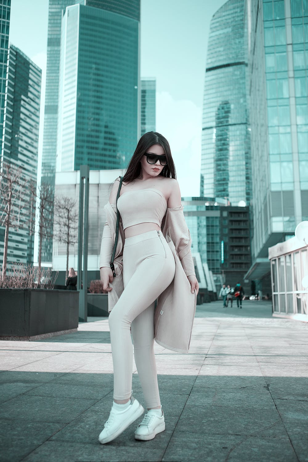 stylish woman in athleisurewear in the city