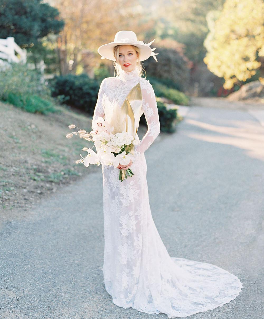 bride in wedding dress wearing bridal hat