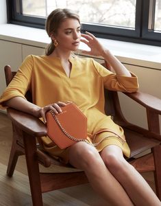 orange hexagonal bag by Bee and Kin
