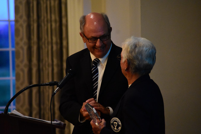Mr. Horton presents Jean St. Charles with Award