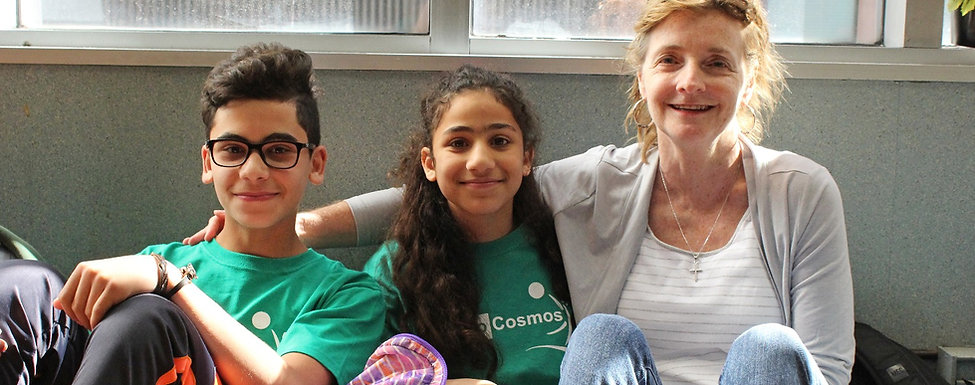 Paula Kline, a member of the Camp Cosmos Board of Directors, poses with two returning campes