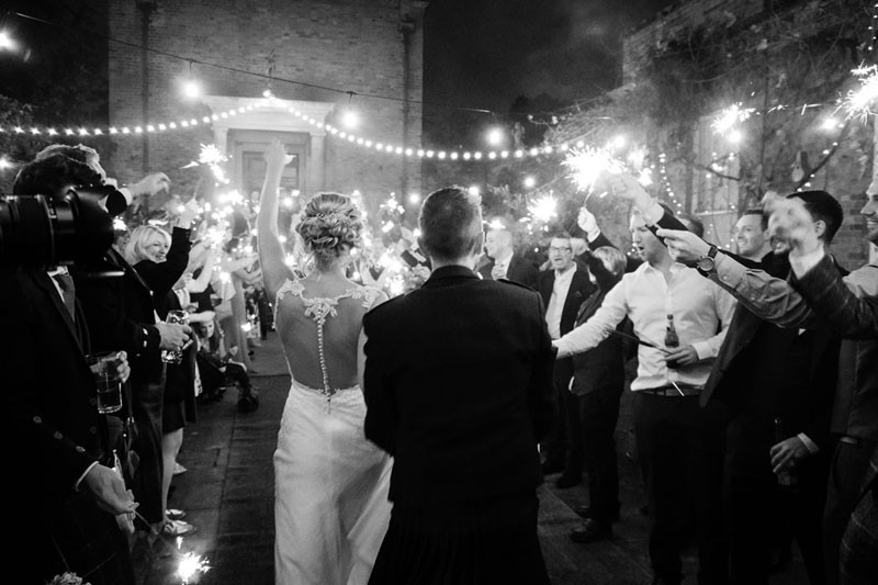 Courtyard at night with sparklers
