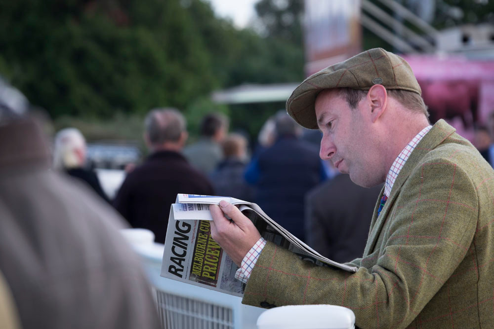 Racing post being read